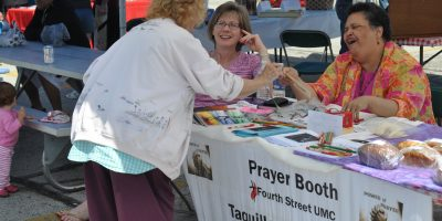 Prayer booth at farmer's market.