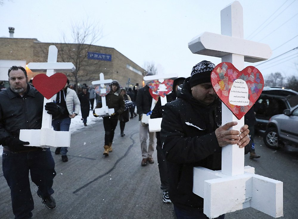 Moving crosses at Aurora mass shooting site.