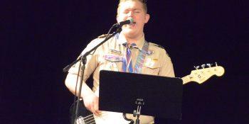 Eagle Scout Thomas Larsen sings on Scout Sunday.