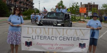 Dominican Literacy Center begins parade march.