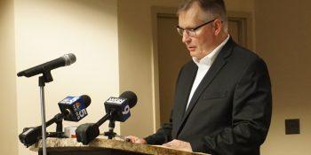 Rev. Daniel Haas addresses media.