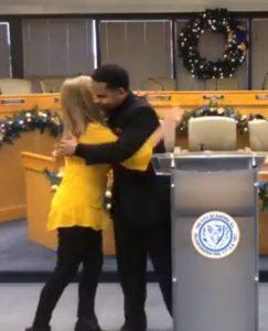 Robin Sterkel of Urban Youth Ministry embraced by Aurora Mayor Richard Irvin