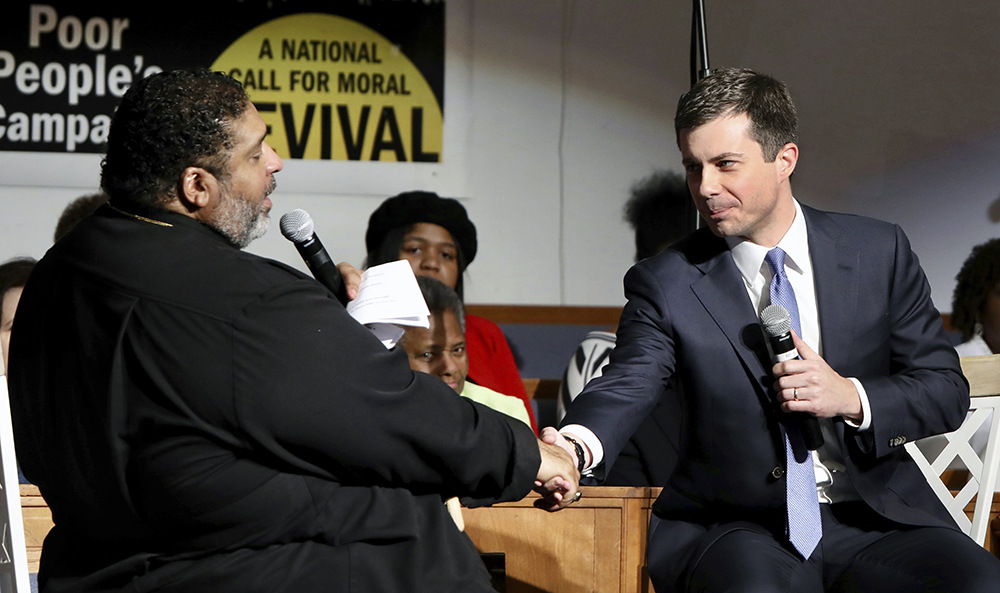 Pete Buttigieg with Rev. Dr. William J. Barber II