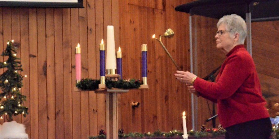 Lighting last Advent candle