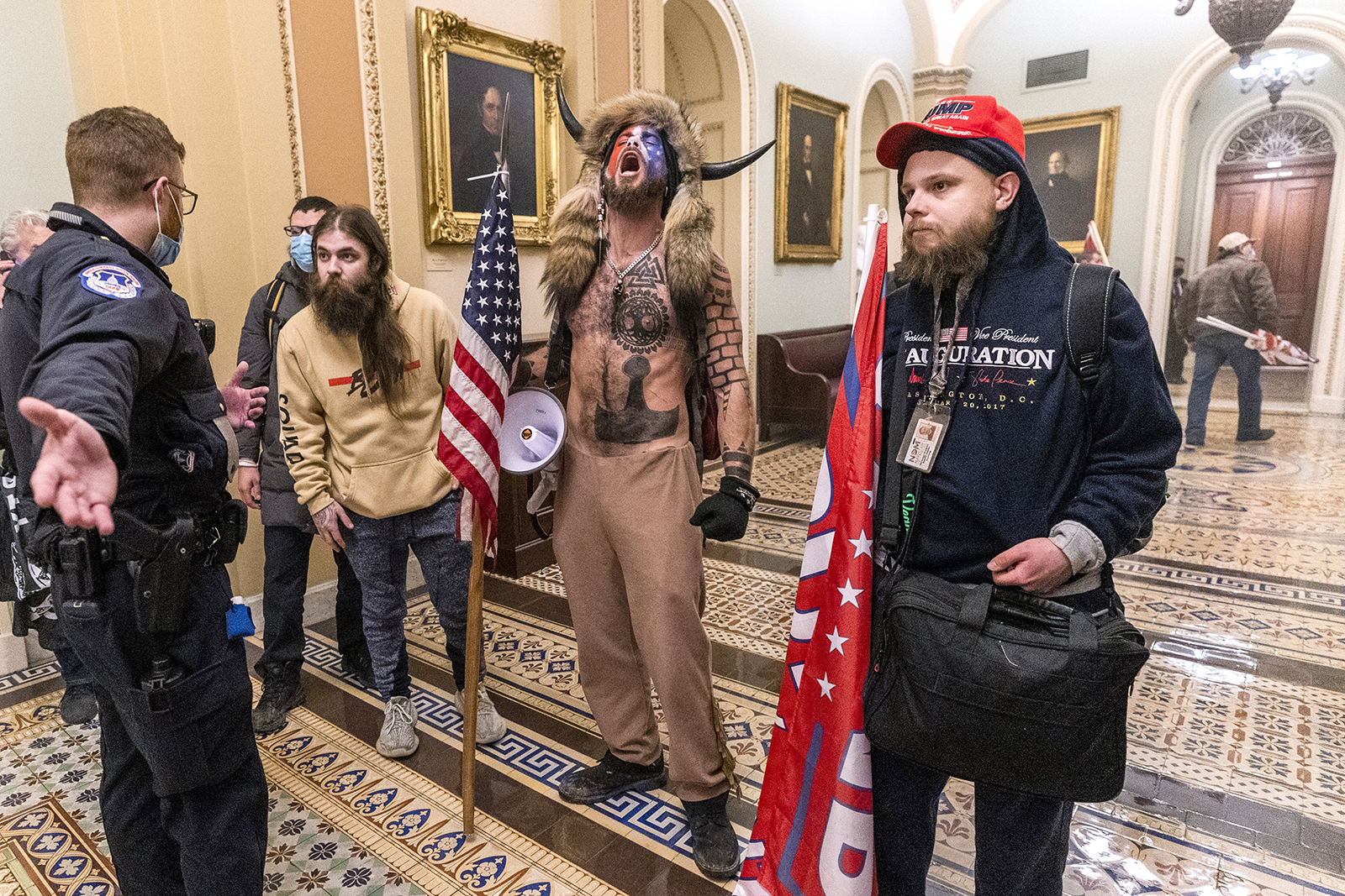 Insurrectionists gather inside the Capitol.