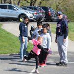 Girl throws baseball