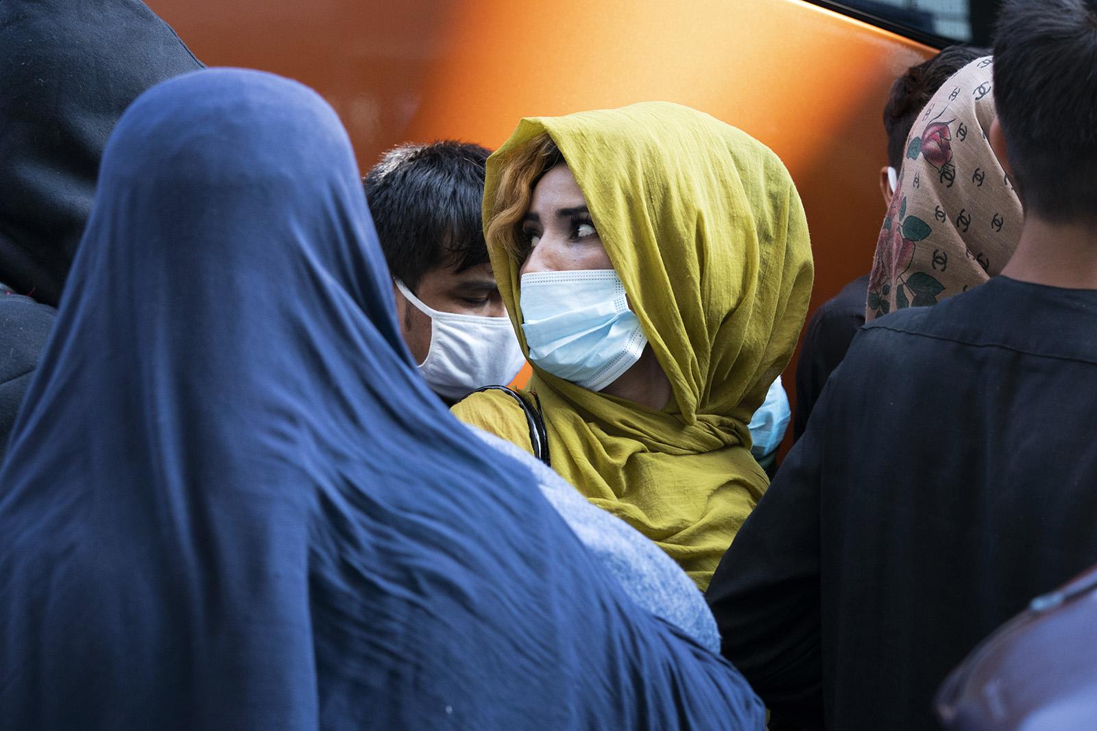 Afghans arrive in US.