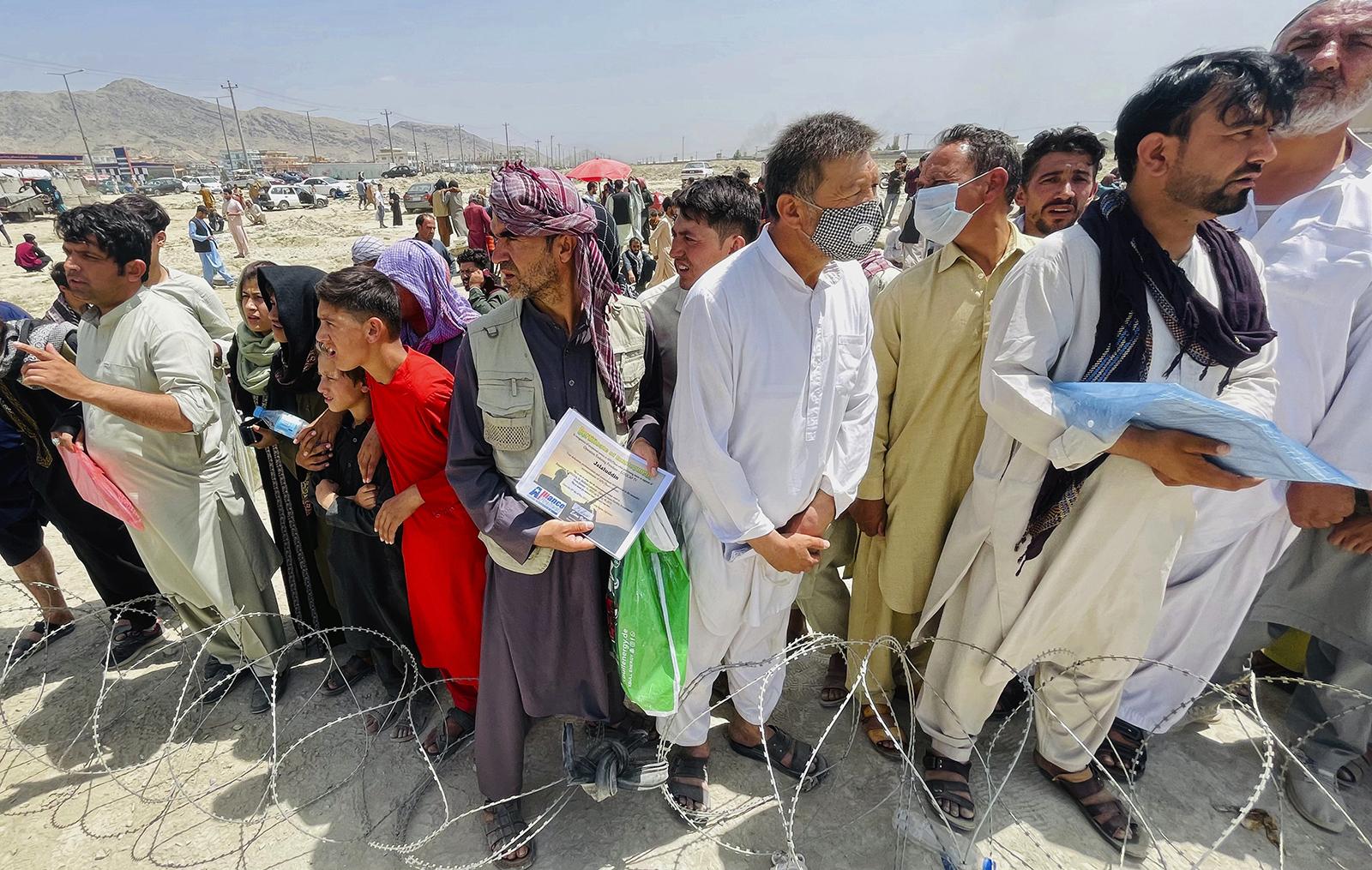 Afghans at Kabul airport.